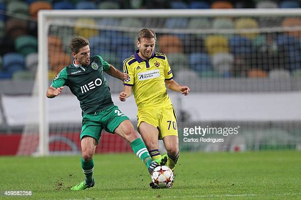 LISBON PORTUGAL NOVEMBER Sporting's midfielder Adrien Silva vies with Maribor's midfielder Ales Mertelj during the UEFA Champions League match...