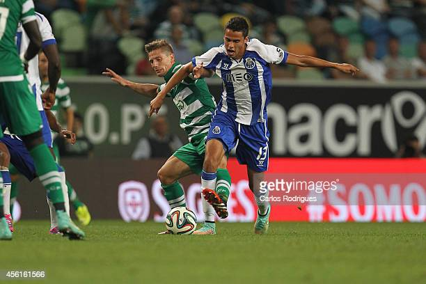 Sporting's midfielder Adrien Silva vies with Porto's defender Diego Reyes during the Primeira Liga match between Sporting CP and FC Porto at Estadio...