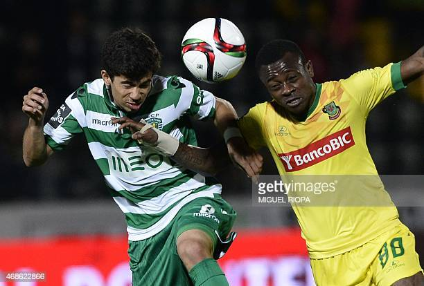 Sporting's midfielder Andre Martins heads the ball with Pacos Ferreira's Ivorian midfielder Jean Michael Seri during the Portuguese league football...