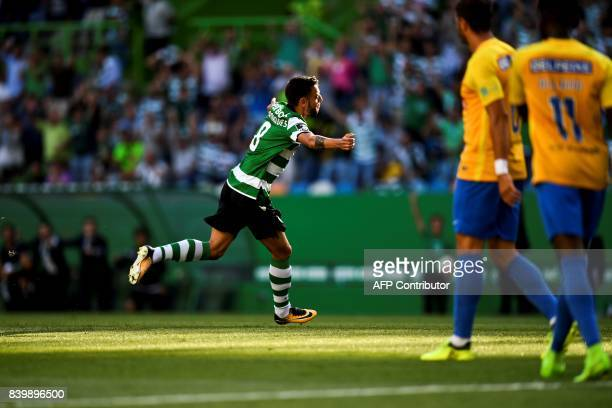 Sporting's midfielder Bruno Fernandes celebrates after scoring during the Portuguese league football match Sporting CP vs Estoril Praia at the Jose...