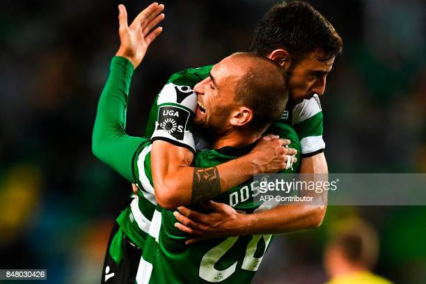 Sporting's midfielder Bruno Fernandes celebrates with his teammate Sporting's Dutch forward Bas Dost after scoring during the Portuguese league...