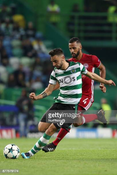 Sporting's midfielder Bruno Fernandes from Portugal vies with Olympiacos' midfielder Alaixys Romao during the UEFA Champions League group D football...