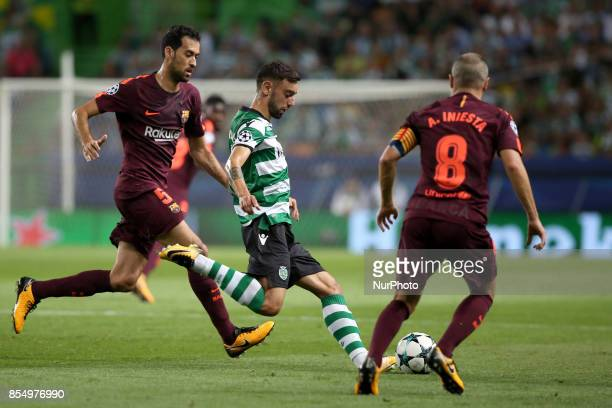 Sporting's midfielder Bruno Fernandes from Portugal vies with Barcelona's Spanish midfielder Sergio Busquets and Barcelona's Spanish midfielder...