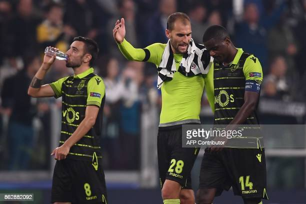 Sporting's midfielder Bruno Fernandes Sporting's Dutch forward Bas Dost and Sporting's midfielder William Carvalho react at the end of the UEFA...