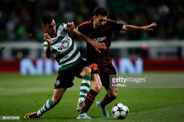 Sporting's midfielder Bruno Fernandes vies for the ball with Barcelona's forward Lionel Messi during the Champions League 2017/18 match between...