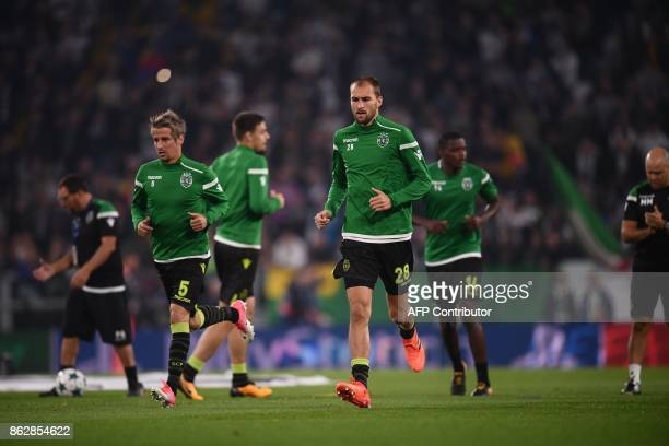 Sporting's midfielder Fabio Coentrao and Sporting's Dutch forward Bas Dost warm up before the UEFA Champions League Group D football match Juventus...