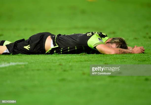 Sporting's midfielder Fabio Coentrao lies on the pitch at the end of the Portuguese league football match Moreirense FC vs Sporting CP at the...