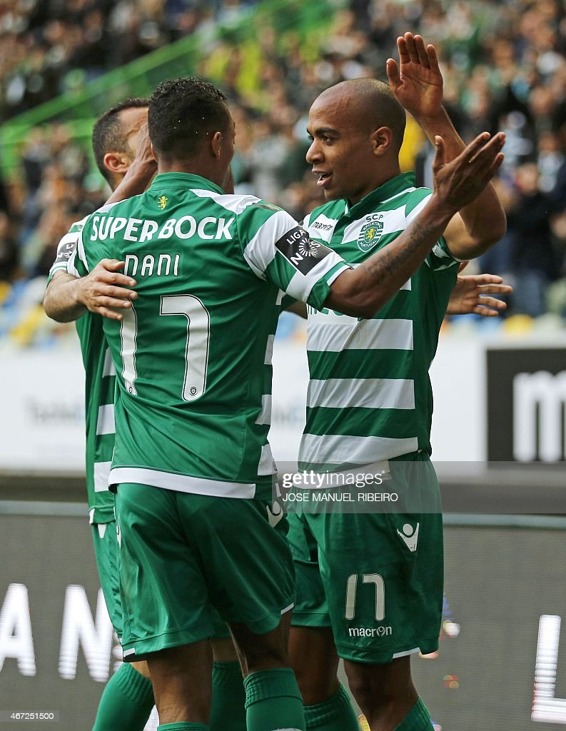Sporting's midfielder Joao Mario (R) celebrates his goal with teammate midfielder Luis Carlos da Cunha '<a gi-track='captionPersonalityLinkClicked' href=/galleries/search?phrase=Nani+-+Soccer+Player&family=editorial&specificpeople=11510994 ng-click='$event.stopPropagation()'>Nani</a>' (C) during the Portuguese Liga football match Sporting CP vs Vitoria FC Guimaraes at the Jose Alvalade stadium in Lisbon on March 22, 2015. AFP PHOTO / JOSE MANUEL RIBEIRO