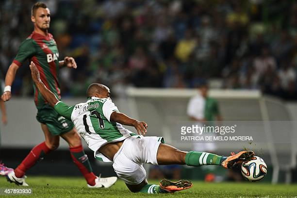 Sporting's midfielder Joao Mario scores during the Portuguese league football match Sporting CP vs Maritimo at the Alvalade stadium in Lisbon on...
