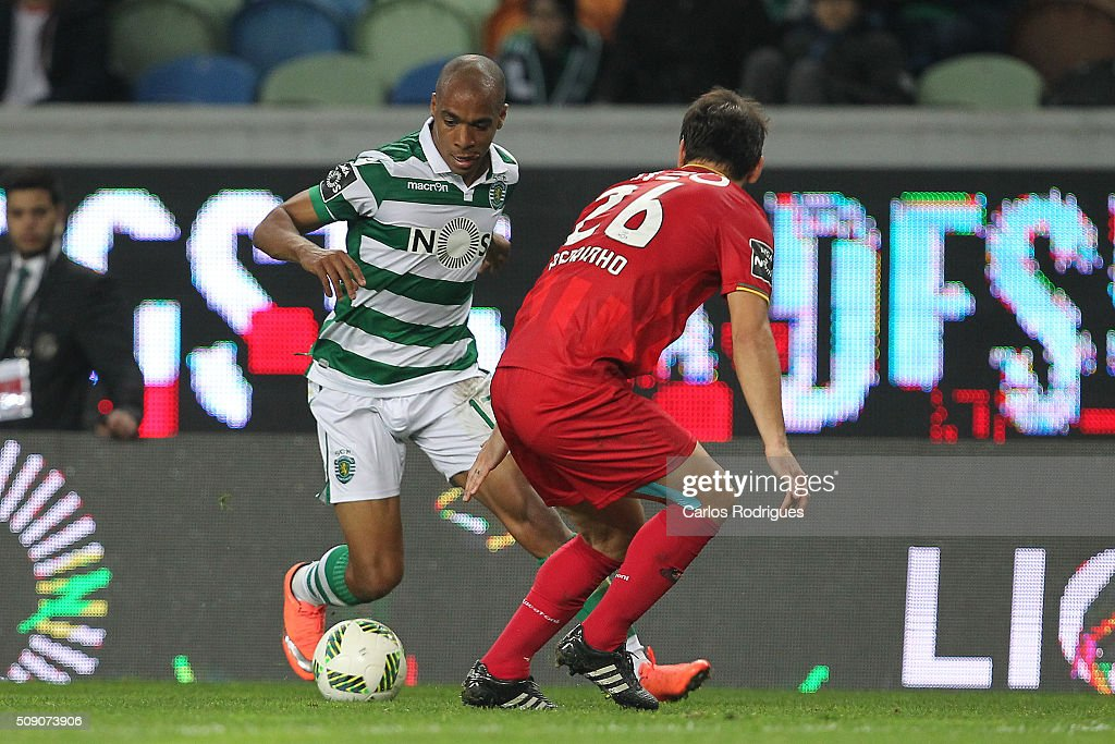 Sporting's midfielder Joao Mario tries to pass through Rio Ave's defender Pedrinho during the match between Sporting CP and Rio Ave FC for the Portuguese Primeira Liga at Jose Alvalade Stadium on February 08, 2016 in Lisbon, Portugal.