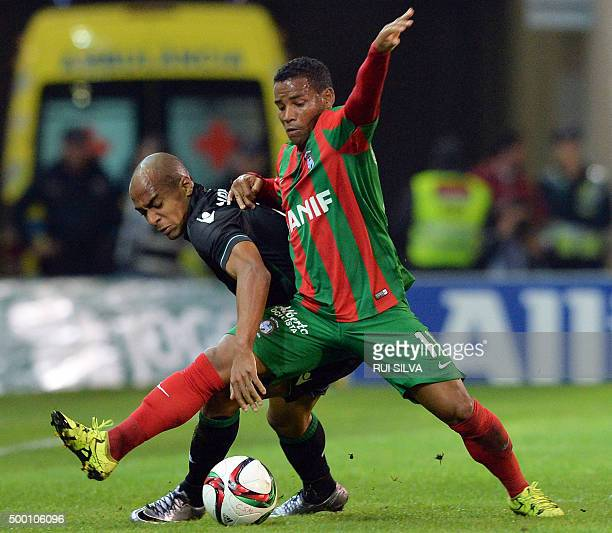 Sporting's midfielder Joao Mario vies with Maritimo Funchal's Brazilian midfielder Eber Henrique Ferreira De Bessa during the Portuguese league...