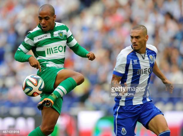 Sporting's midfielder Joao Mario vies with Porto's Brazilian defender Maicon during the Portuguese Cup football match FC Porto vs Sporting CP at the...