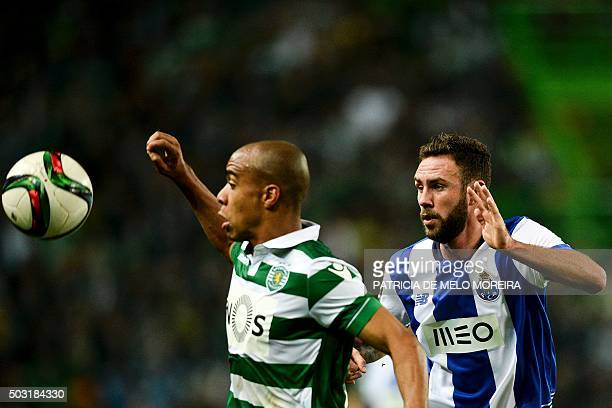 Sporting's midfielder Joao Mario vies with Porto's Mexican defender Miguel Layun during the Portuguese League football match Sporting CP vs FC Porto...