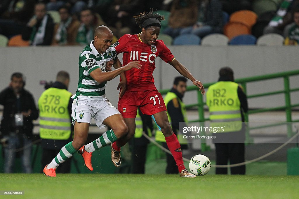 Sporting's midfielder Joao Mario (L) vies with Rio Ave's forward Joris Kayembe Ditu (D) during the match between Sporting CP and Rio Ave FC for the Portuguese Primeira Liga at Jose Alvalade Stadium on February 08, 2016 in Lisbon, Portugal.