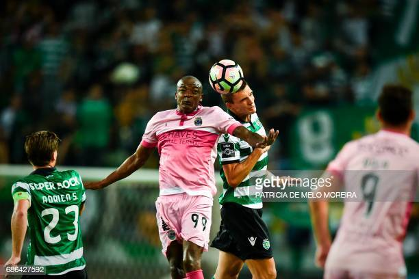 Sporting's midfielder Joao Palhinha heads the ball with Chaves' Brazilian forward William Oliveira during the Portuguese league football match...