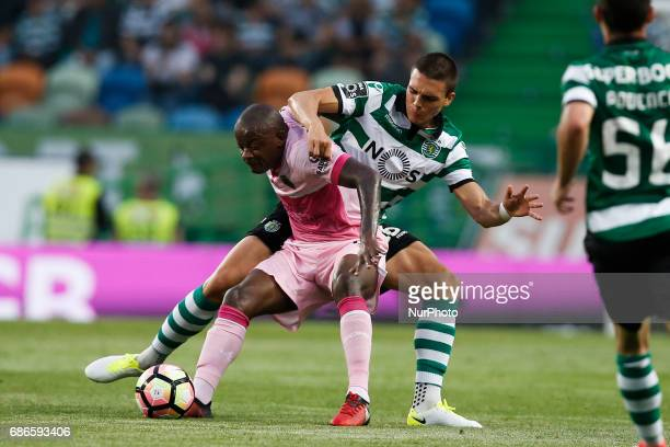 Sporting's midfielder Joao Palhinha vies for the ball with Chaves's forward William during Premier League 2016/17 match between Sporting CP vs GD...