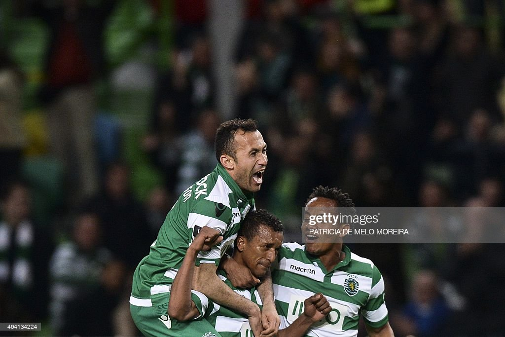 Sporting's midfielder Luis Carlos da Cunha '<a gi-track='captionPersonalityLinkClicked' href=/galleries/search?phrase=Nani+-+Soccer+Player&family=editorial&specificpeople=11510994 ng-click='$event.stopPropagation()'>Nani</a>' (C) celebrates with his teammates Sporting's Brazilian defender Jefferson Nascimento (L) and Sporting's Peruvian forward Andre Carrilho (R) after scoring during the Portuguese league football match Sporting CP vs Gil Vicente FC at the Alvalade stadium in Lisbon, on February 22, 2015.