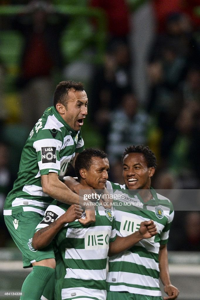 Sporting's midfielder Luis Carlos da Cunha '<a gi-track='captionPersonalityLinkClicked' href=/galleries/search?phrase=Nani+-+Soccer+Player&family=editorial&specificpeople=11510994 ng-click='$event.stopPropagation()'>Nani</a>' (C) celebrates with his teammates Sporting's Brazilian defender Jefferson Nascimento (L) and Sporting's Peruvian forward Andre Carrilho (R) after scored against Gil Vicente during the Portuguese league football match Sporting CP vs Gil Vicente FC at the Alvalade stadium in Lisbon, on February 22, 2015. AFP PHOTO / PATRICIA DE MELO MOREIRA