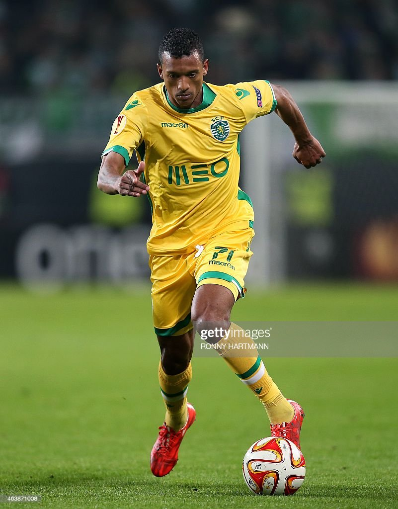 Sporting's midfielder Luis Carlos da Cunha '<a gi-track='captionPersonalityLinkClicked' href=/galleries/search?phrase=Nani+-+Soccer+Player&family=editorial&specificpeople=11510994 ng-click='$event.stopPropagation()'>Nani</a>' runs with the ball during UEFA Europa League Round of 32 football match between VfL Wolfsburg v Sporting Portugal on February 19, 2015 in Wolfsburg, Germany. AFP PHOTO / RONNY HARTMANN