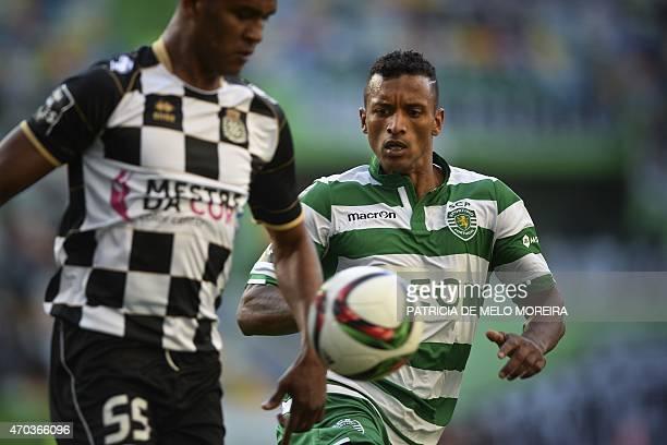 Sporting's midfielder Luis Carlos da Cunha 'Nani' vies with Boavista's Honduran defender Brayan Beckeles during the Portuguese league football match...