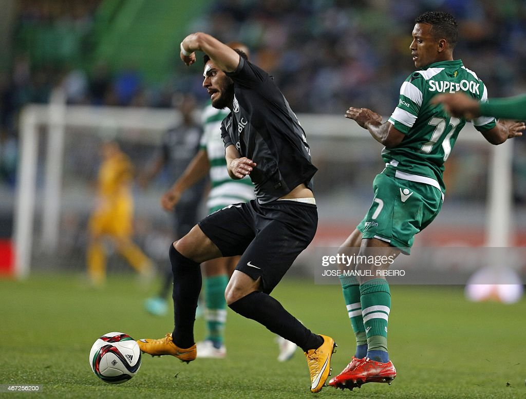 Sporting's midfielder Luis Carlos da Cunha '<a gi-track='captionPersonalityLinkClicked' href=/galleries/search?phrase=Nani+-+Soccer+Player&family=editorial&specificpeople=11510994 ng-click='$event.stopPropagation()'>Nani</a>' (r) vies with Guimaraes forward Ricardo Valente during the Portuguese Liga football match Sporting CP vs Vitoria FC Guimaraes at the Jose Alvalade stadium in Lisbon on March 22, 2015. AFP PHOTO/ JOSE MANUEL RIBEIRO