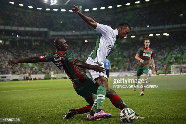Sporting's midfielder Luis Carlos da Cunha 'Nani' vies with Maritimo's Guinea midfielder Danilo Pereira during the Portuguese league football match...