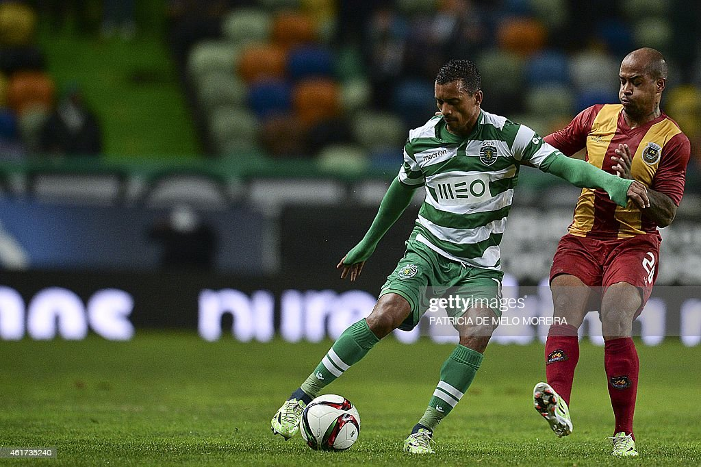 Sporting's midfielder Luis Carlos da Cunha '<a gi-track='captionPersonalityLinkClicked' href=/galleries/search?phrase=Nani+-+Soccer+Player&family=editorial&specificpeople=11510994 ng-click='$event.stopPropagation()'>Nani</a>' (L) vies with Rio Ave's Venezuelan forward Del Valle (R) during the Portuguese league football match Sporting vs Rio Ave at Alvalade stadium in Lisbon on January 18, 2015.
