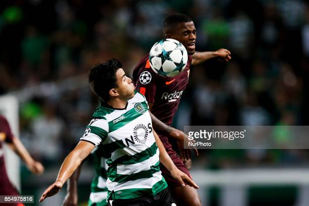 Sporting's midfielder Marcos Acuna vies for the ball with Barcelona's defender Nelson Semedo during the Champions League 2017/18 match between...