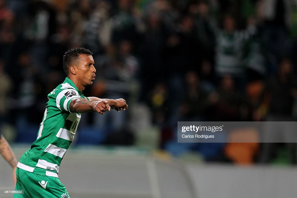 Sporting's midfielder <a gi-track='captionPersonalityLinkClicked' href=/galleries/search?phrase=Nani+-+Soccer+Player&family=editorial&specificpeople=11510994 ng-click='$event.stopPropagation()'>Nani</a> celebrates scoring Sporting Fourth goal during the Primeira Liga Portugal match between Sporting CP and Vitoria Guimaraes at Estadio Jose Alvalade on March 22, 2015 in Lisbon, Portugal.
