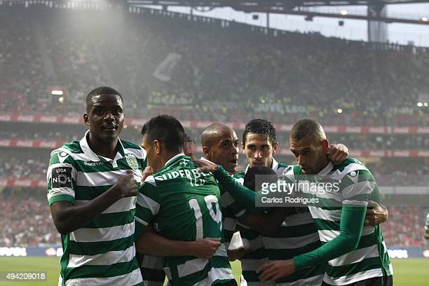 Sporting's midfielder William Carvalho celebrates with his team mates Sporting«s first goal scored by Sporting's forward Teofilo Gutierrez during the...