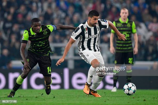 Sporting's midfielder William Carvalho fights for the ball with Juventus' midfielder from Germany Sami Khedira during the UEFA Champions League Group...