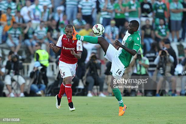 Sporting's midfielder William Carvalho tackles Braga's defender Aderlan Santos during the Portuguese Cup Final between Sporting CP and SC Braga at...