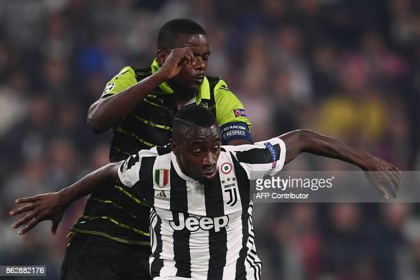 Sporting's midfielder William Carvalho vies with Juventus' midfielder from France Blaise Matuidi during the UEFA Champions League Group D football...