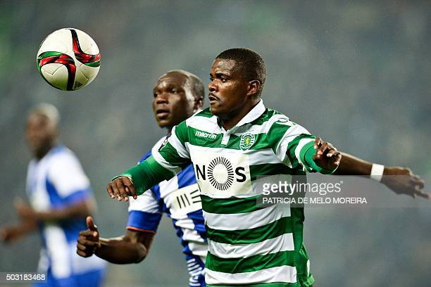 Sporting's midfielder William Carvalho vies with Porto's Cameroonian forward Vincent Aboubakar during the Portuguese League football match Sporting...