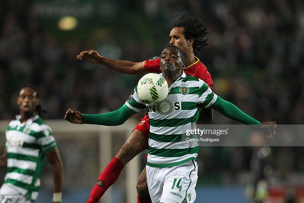 Sporting's midfielder William Carvalho vies with Rio Ave's forward Kuca during the match between Sporting CP and Rio Ave FC for the Portuguese Primeira Liga at Jose Alvalade Stadium on February 08, 2016 in Lisbon, Portugal.