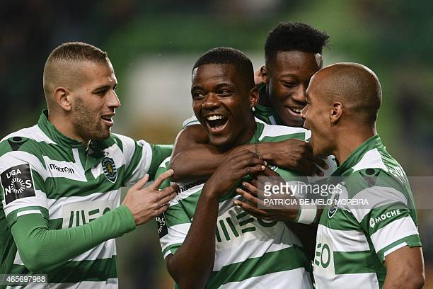 Sporting's midfielder William Silva de Carvalho celebrates with teammates after scoring during the Portuguese league football match Sporting CP vs FC...
