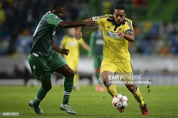 Sporting's midfielder William Silva de Carvalho vies with Maribor's Brazilian forward Tavares during the UEFA Champions League football match...