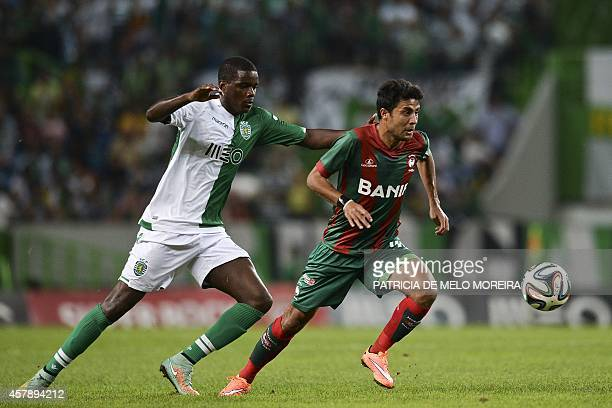 Sporting's midfielder William Silva de Carvalho vies with Maritimo's Egyptian forward Mohamed Ibrahim during the Portuguese league football match...