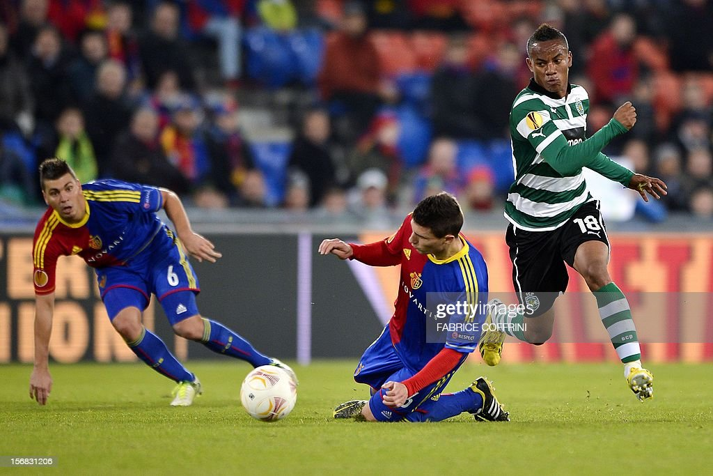 Sporting's Peruvian forward Andre Carrillo (R) vies for the ball with FC Basel's Serbian defender Aleksandar Dragovic (L) and his teammate defender Fabian Schaer during their Europa League UEFA Europa League Group G football match between FC Basel and Sporting Clube de Portugal on November 22, 2012 in Basel. Basel won 3-0.