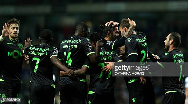 Sporting's players celebrate a goal during the Portuguese league football match Boavista FC vs Sporting CP at the Estadio do Bessa Seculo XXI in...