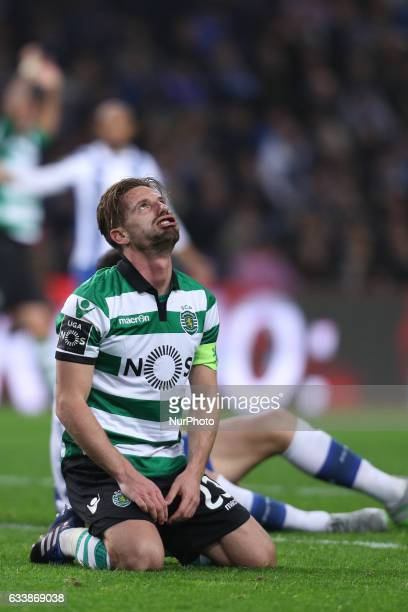 Sporting's Portuguese midfielder Adrien Silva reacts after missing a goal during the Premier League 2016/17 match between FC Porto and Sporting CP at...