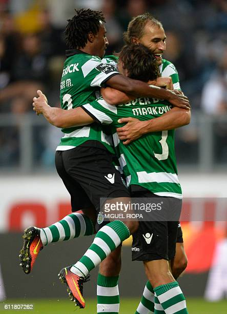 Sporting's Serbian forward Lazar Markovic celebrates with teammates forward Gelson Martins and Dutch forward Bas Dost after scoring a goal during the...