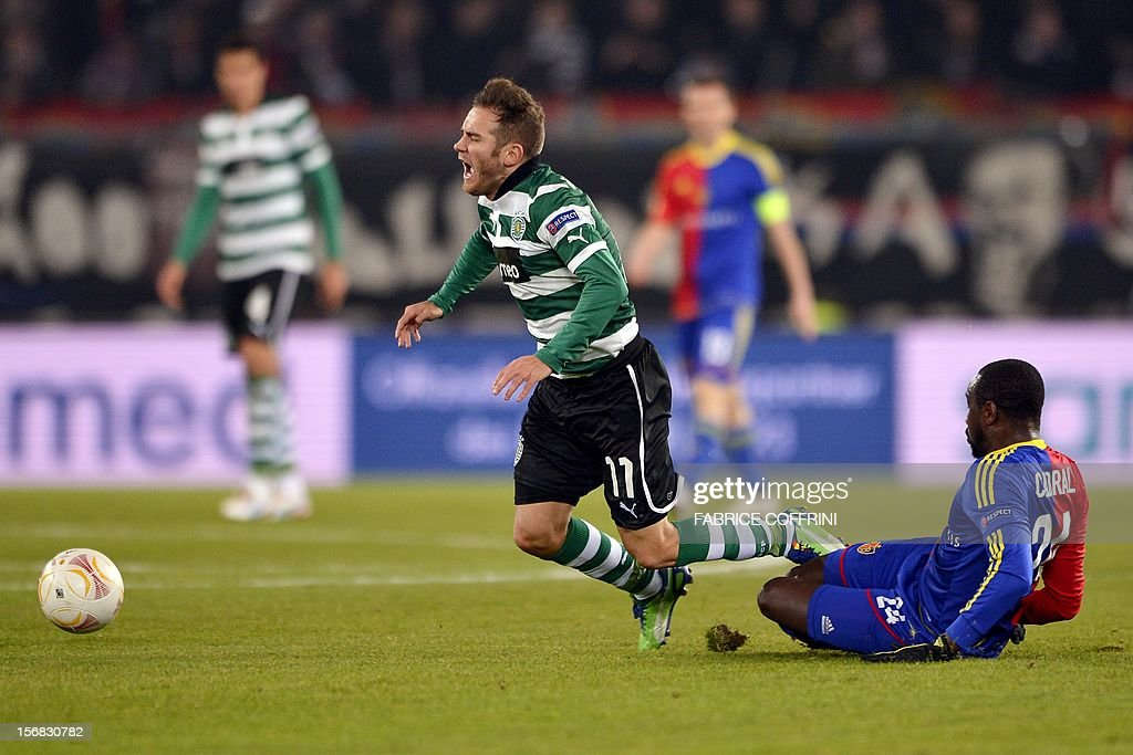 Sporting's Spanish midfielder Diego Capel (C) is fouled by FC Basel's midfielder Adilson Tavares Varela Cabral (R) during their Europa League UEFA Europa League Group G football match between FC Basel and Sporting Clube de Portugal on November 22, 2012 in Basel. Cabral received a red card.