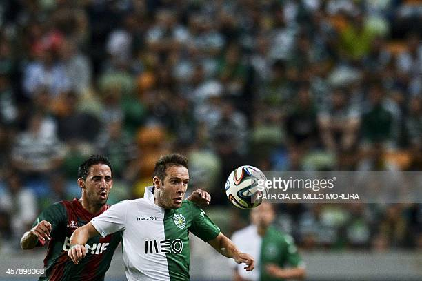 Sporting's Spanish midfielder Diego Capel vies with Maritimo's defender Joao de Freitas during the Portuguese league football match Sporting CP vs...