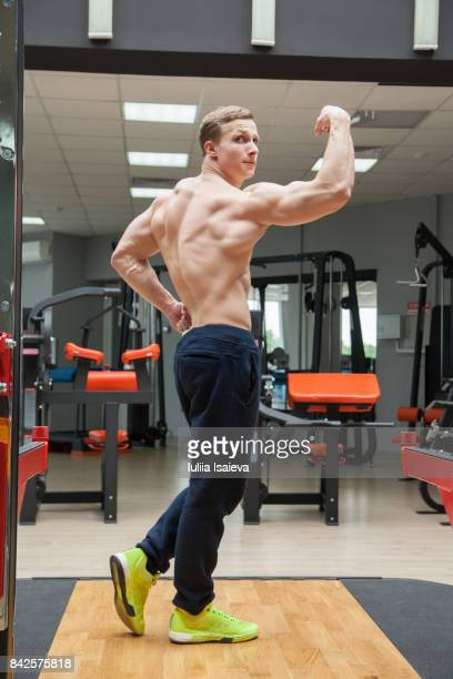 Sportive man showing muscles