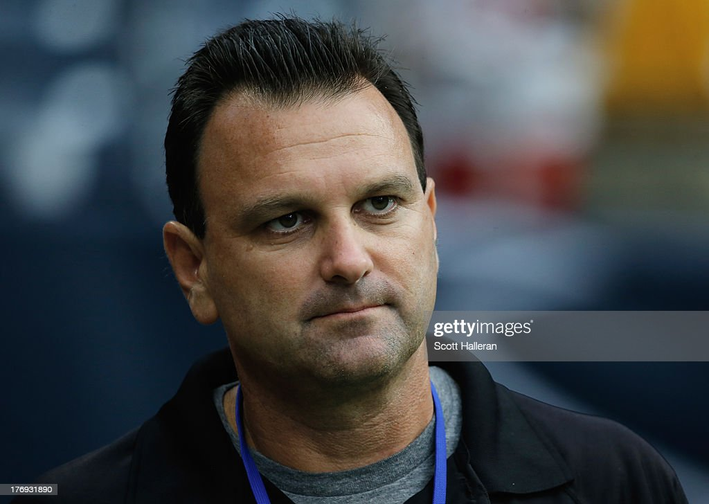 Sports agent Drew Rosenhaus walks on the sideline before a preseaon game between the Miami Dolphins and the Houston Texans at Reliant Stadium on August 17, 2013 in Houston, Texas.