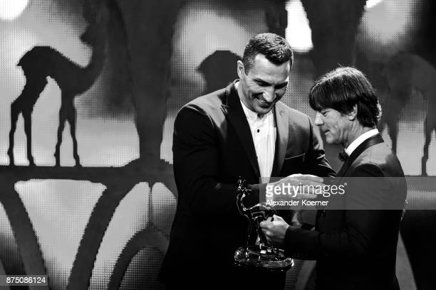 'Sports' award winner Wladimir Klitschko and Joachim Loew on stage at the Bambi Awards 2017 show at Stage Theater on November 16 2017 in Berlin...