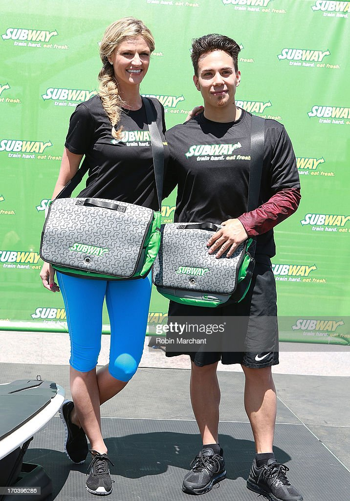 Sports broadcaster Erin Andrews (L) and olympic speed skater Apolo Ohno attend the limited edition SUBWAY bag unveiling with Apolo Ohno at Clinton Cove At Pier 96 on June 12, 2013 in New York City.