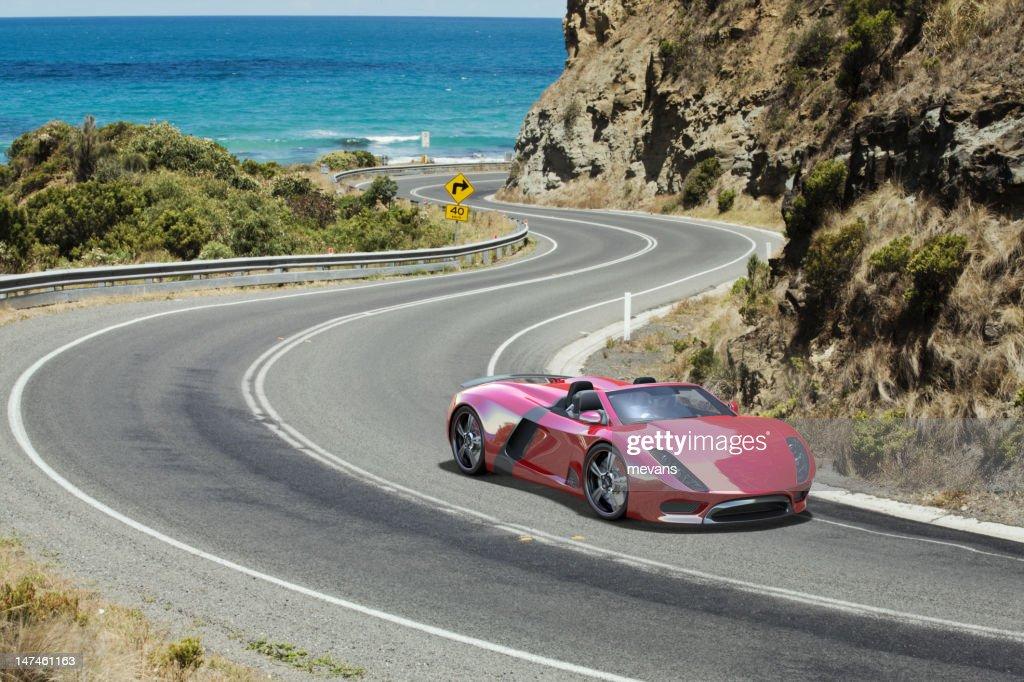 Sports Car on a Coastal Road. : Stock Photo