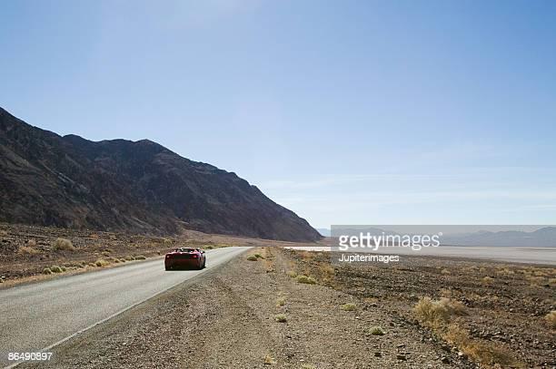 Sports car on desert road